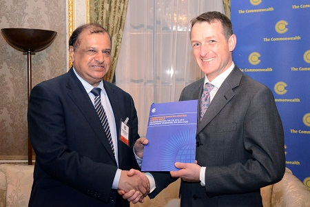 Chair of the Working Group, Dr the Hon Vasant K Bunwaree, Minister of Education and Human Resources, Mauritius, presents the recommendations to Mr David Hallam, representing the British Prime Minister, David Cameron, co-chair of the United Nations High Level Panel of Eminent Persons on the Post-2015 Development Agenda. © Commonwealth Secretariat 2012
