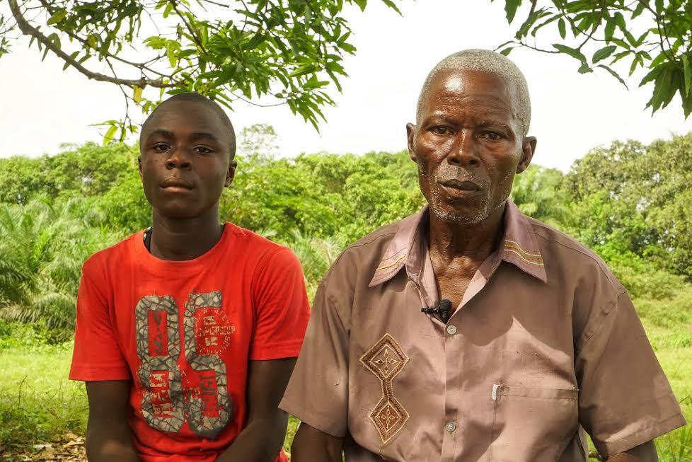 Samuel Nyah with his son Benedict, 16, a student at the Bridge-run Cinta Public School