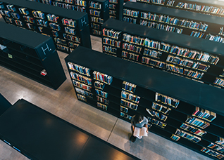 University student studying in library – Jacob Lund - Shutterstock